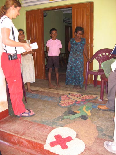 J. Carter Ingram (left) discusses coconut-based             handicraft and ropemaking business with local women in             Thallala.