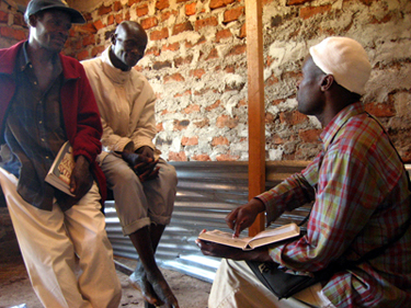 Benjamin Okalo (right) interviews village elders about their knowledge of birds and bird folklore.