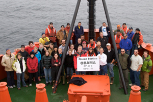 Researchers and crew aboard the Laurence M Gould. Holding sign at left, chief scientist Douglas Martinson.