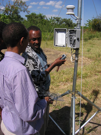 Ethiopian National Meteorological Agency technicians collect rainfall data