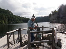 Paul Huth checks the Mohonk Preserve's temperature station, unmoved since the 1890s.