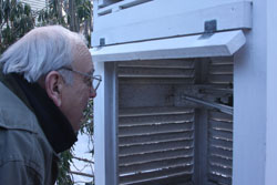 A brass National Weather Service rain gauge at the resort's boat dock is the 1896 original.