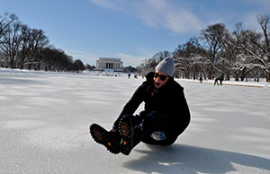 Unusually cold weather turned the Lincoln Memorial Reflecting Pool into an ice rink. Credit: FamousDC.com