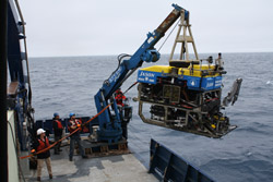 Crew members prepare the remotely operated vehicle Jason to dive to Axial Seamount.