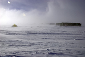 Researchers endured extreme wind and cold at a high-elevation field camp near the center of the ice sheet. (Michael Studinger/AGAP)