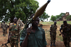 The long war leading to South Sudan's recent independence began during the powerful El Niño drought of 1983. In continuing hostilities, southern fighters display a grenade launcher captured from northern Sudanese, July 2011.