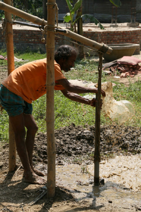 A Bangladeshi worker drills a sampling well. Local crews have been working with researchers for over a decade. (Courtesy Kathleen Radloff)
