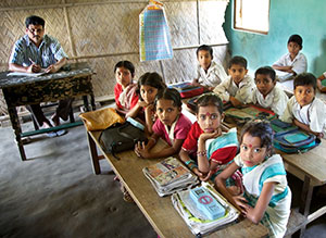 Schoolchildren in Assam, India. India has made efforts to boost the number of children attending school: The number of out-of-school children declined from 25 million in 2003 to 8.1 million in 2009. Gender and social gaps in enrollment have also narrowed. Photo: Michael Foley/World Bank