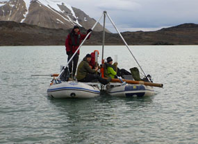 From a coring platform perched atop two inflatable rafts, scientists in Svalbard can raise sediment cores from the lakebed below.