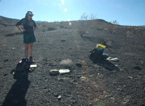 Geochemists dated the crater by analyzing rocks thrown out when it exploded. Lead author Peri Sasnett contemplates a sample.