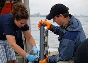 A new study finds widespread presence of antibiotic-resistant bacteria in the Hudson River. Coauthor Gregory O'Mullan (right) collects samples on the lower Hudson. (Kevin Krajick)