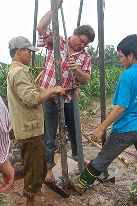 Left to right: A driller, and study coauthors Benjamin Bostick and Nguyen-Ngoc Mai work at a high-arsenic well near the village of Van Phuc
