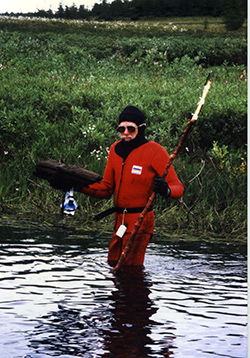Jacoby often packed a wetsuit on expeditions to dive for old, submerged trees–here in Russia, circa 1999.