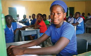 Student Eucharia Ekwealor in the newly renovated Christ the King College classroom block, Umuem, Anambra West Local Government Area, Nigeria.