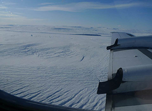 The flat topography seen from a plane over Greenland is in sharp contrast to the jagged features found to be underlying much of the ice sheet.