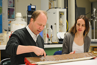 Study coauthor Peter deMenocal (left) took this deep-sea core in the pirate-infested Gulf of Aden. Lead author Jessica Tierney (right) performed an analysis linking greater heat in the past to drier conditions.