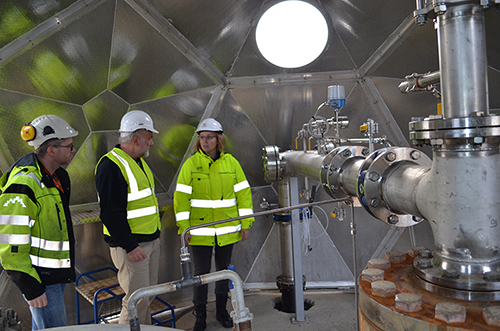 Part of the piping system that pumps emissions back underground. Left to right, engineer Magnus Thor Arnarson, Lamont-Doherty Earth Observatory hydrologist Martin Stute and project leader Edda Sif Arradotir of Reykjavik Energy.
