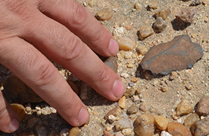 A projectile point, age and makers unknown, on the ground in northwest Kenya, where conditions are now more arid than in the past.