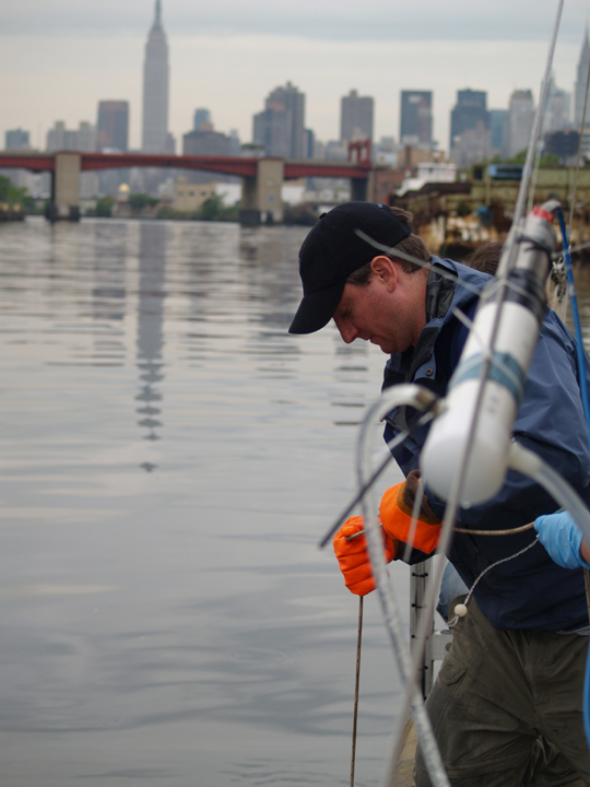 Microbiologist Greg O'Mullan hauls in water from chronically polluted Newtown Creek, Brooklyn. Microbe counts on this day were 232 times acceptable level; bottom waters were nearly devoid of oxygen.